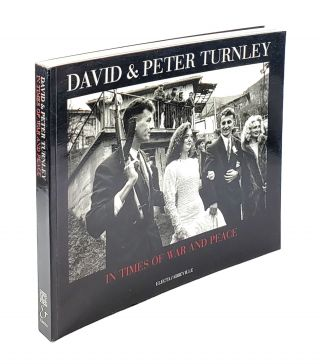 In Times of War and Peace. David Turnley, Peter Turnley